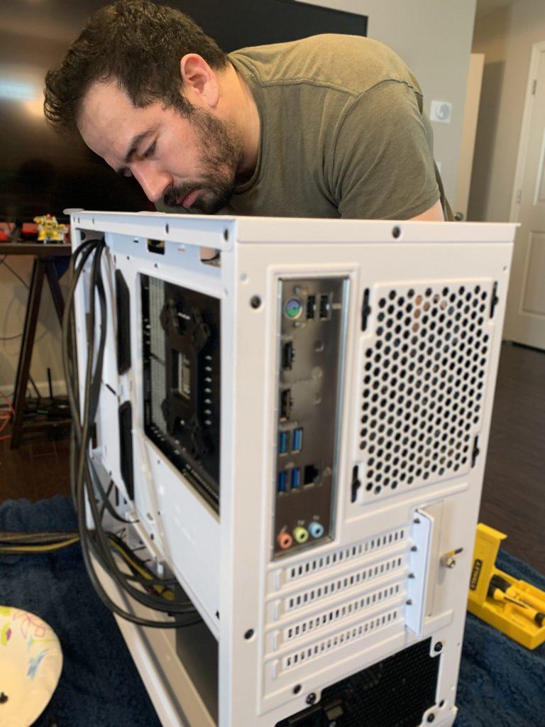 Men fixing computer CPU