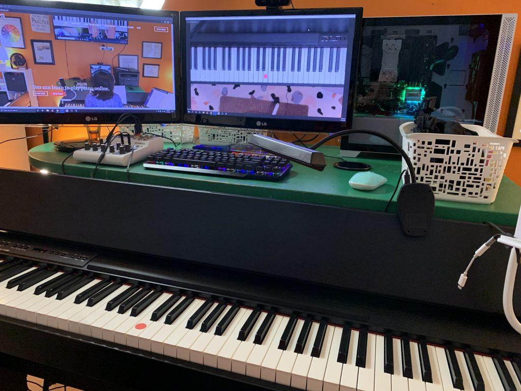 Two monitors and piano keyboard